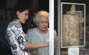 Clare Breay, BL Head Curator Medieval and Earlier Manuscripts, with The Queen.  Photo: British Library
